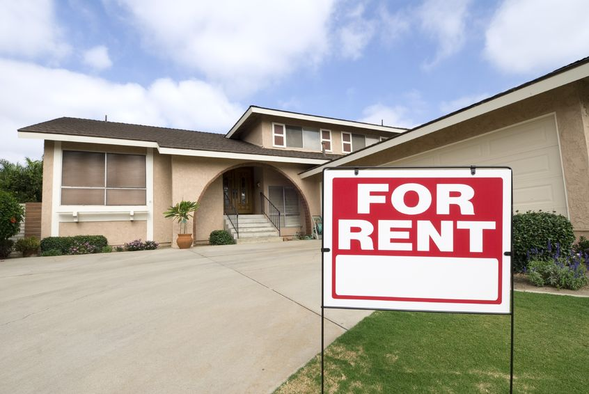 A Home with a For Rent sign in front